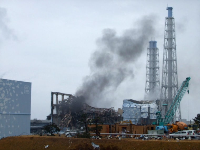 Image: Smoke is seen coming from the area of the No. 3 reactor of the Fukushima Daiichi nuclear power plant in northeastern Japan in this handout photo