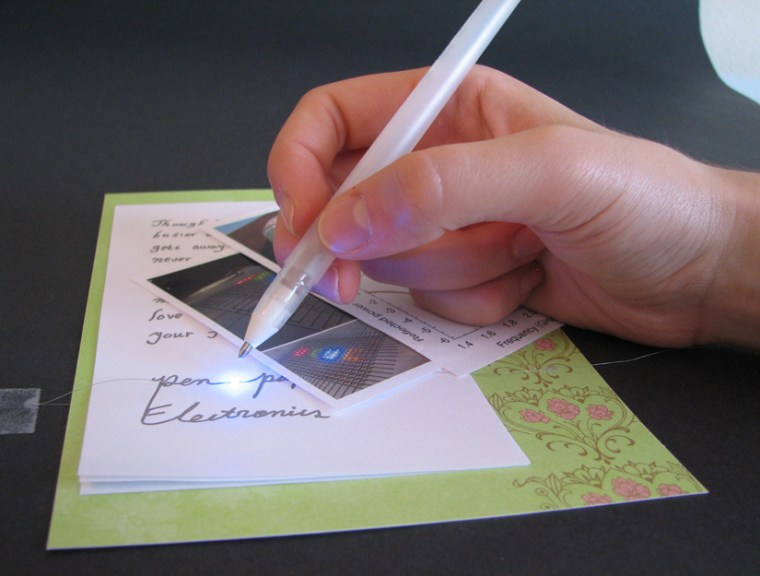 The rollerball pen dispenses conductive silver ink, enabling electrical circuits to be drawn directly on paper and other surfaces.