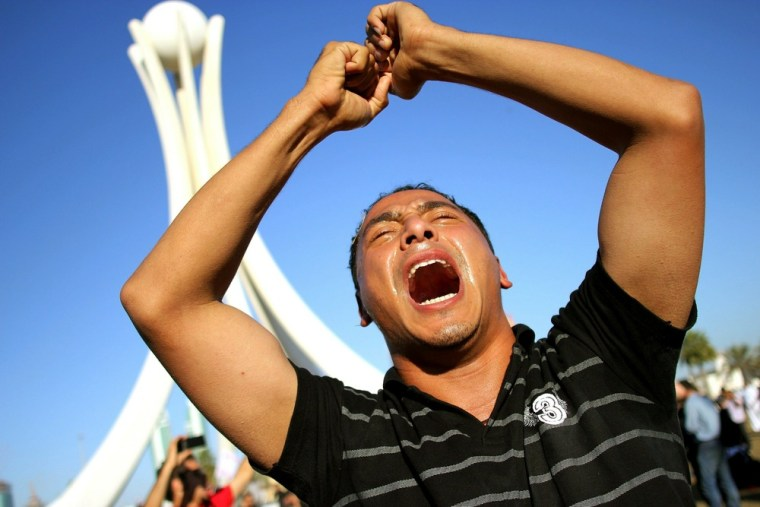 Image: Anti-government demonstrators rally as they re-occupy Pearl roundabout on February 19 in Manama, Bahrain
