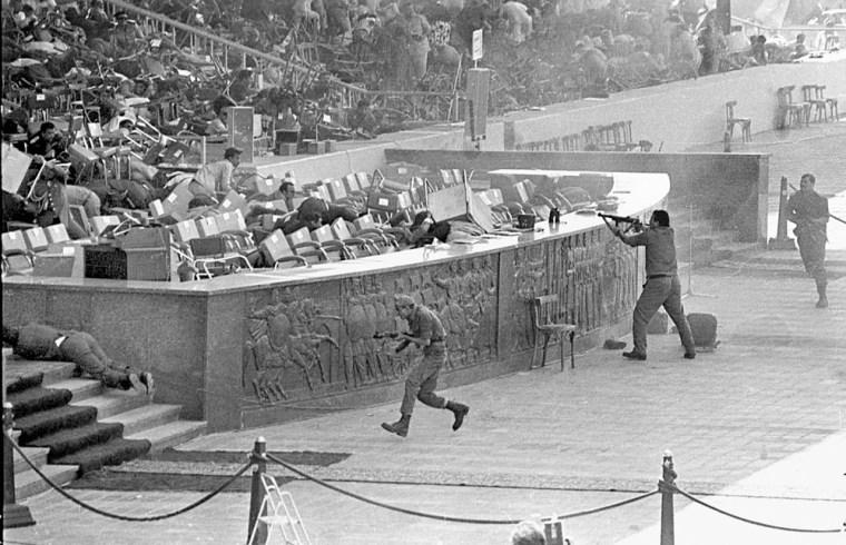 Egyptian soldiers firing on Egyptian President Anwar Al-Sadat in 1981.
