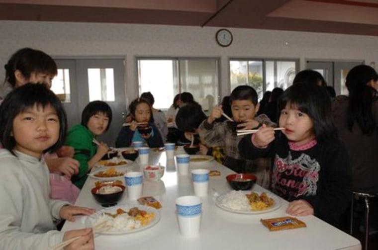 Image: Children enjoy a meal at the Bikou-En Orphanage in Misawa, Japan.