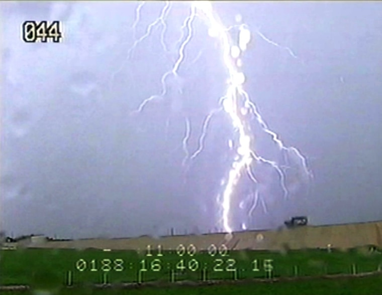 A spectacular bolt of lightning strikes NASA's Kennedy Space Center not far from the shuttle Atlantis' launch pad on Thursday. NASA officials said the lightning did no harm to the shuttle.