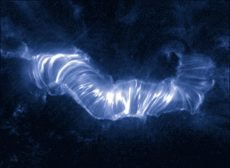One million-degree hot solar plasma travels along magnetic loops in the sun's atmosphere during the Bastille Day solar storm of 2000.
