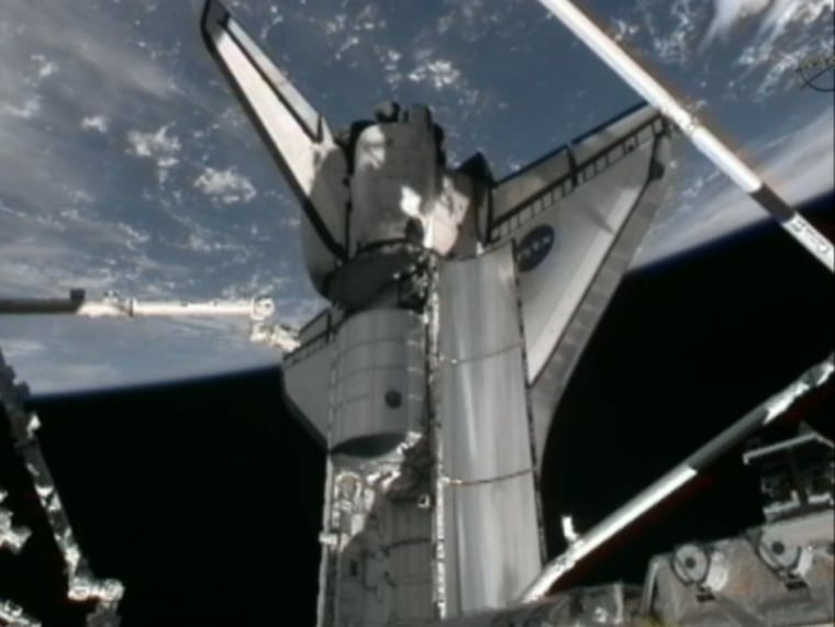 This image from a NASA video camera on the International Space Station shows the Rafaello cargo module on the International Space Station before it was plucked from the shuttle Atlantis' payload bay and delivered to the station. The cargo pod is packed with tons of supplies to keep the station stocked up for an entire year.