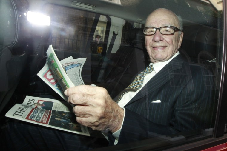 Image: News Corporation CEO Rupert Murdoch is driven away from his flat in central London