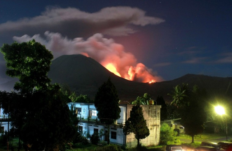 Image: The Lokon volcano erupts near Tomohon on July 15, 2011