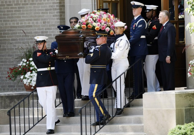 Image: Military pallbearers carry the casket of the former US first lady Betty Ford out of the Grace Episcopal Church after a private funeral service in East Grand Rapids, Michigan