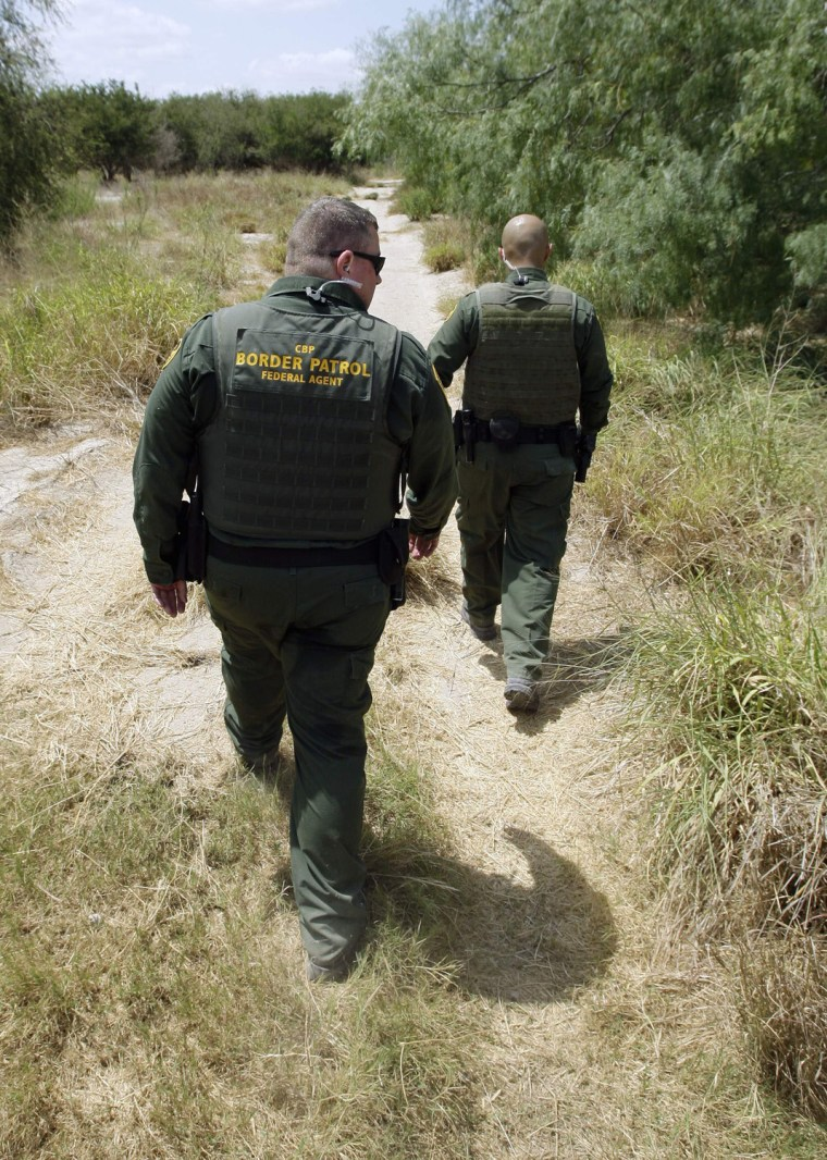 Image: U.S. Customs and Border Patrol agents patrol along the Rio Grande