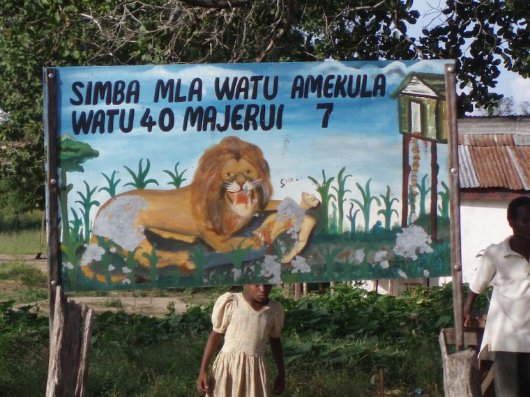 A sign commemorates 40 victims killed by a man-eating lion in the Rufiji District of Tanzania in 2005.