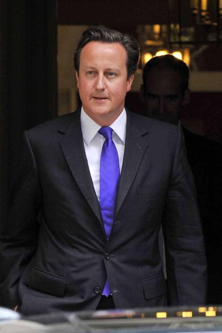 Image: British Prime Minister David Cameron departs 10 Downing Street for parliament on July 20