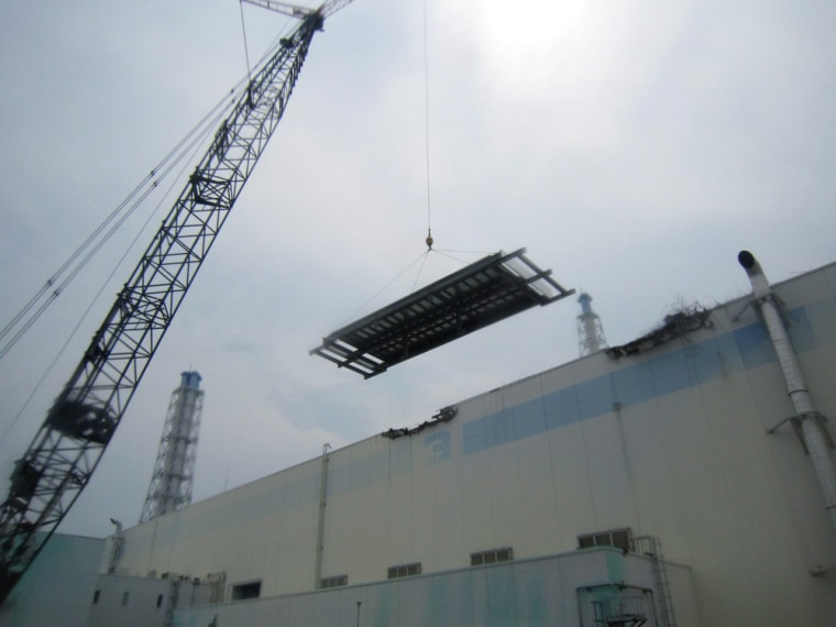 Image: he installation work of the roof as a countermeasure against rainwater and typhoon at the Unit 3 reactor building of the Fukushima Daiichi nuclear power plant