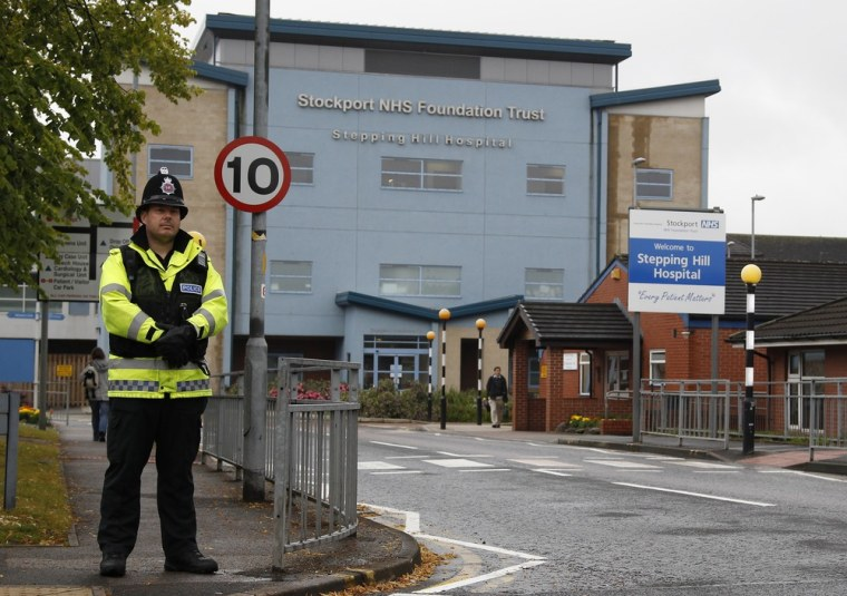 Image: A police officer at Stepping Hill hospital