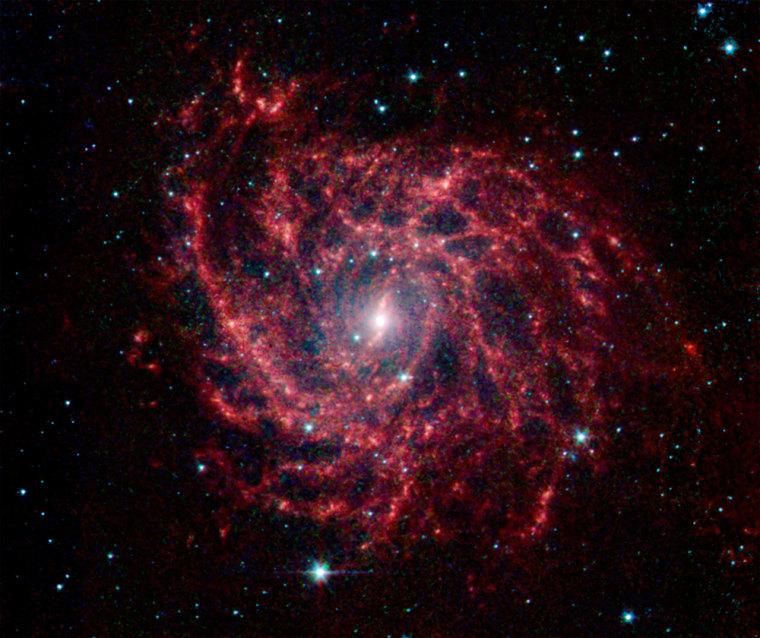 Enhanced telescope photo: galaxy shaped like spider web