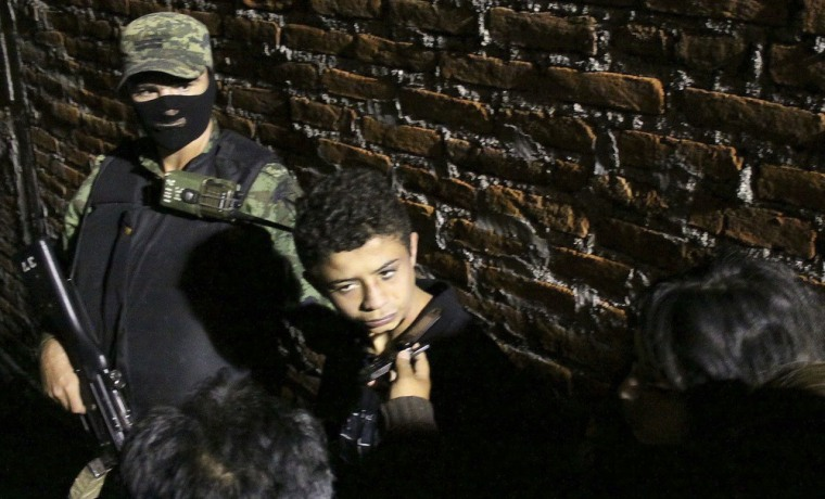 Image: Edgar Jimenez Lugo alias El Ponchis talks to a journalist as he is presented to the media in Cuernavaca
