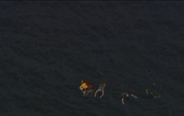 Image: An aerial view shows people swimming in the water close to Utoeya island after the shooting