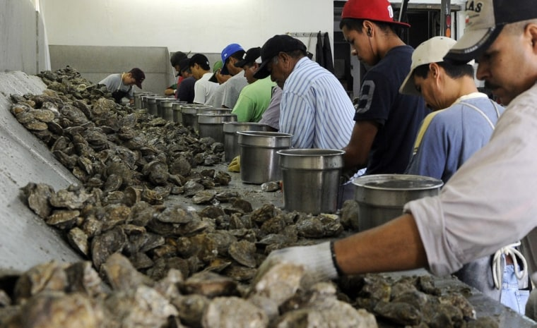 Image: Workers shuck oysters at Jeri's Seafood in Smith Point, Texas