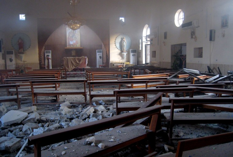 Image: The damaged interior of the holy family Syrian Catholic Church after an early morning car bomb attack in Kirkuk