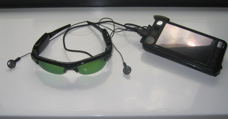 Sunglasses with a tiny webcam in the bridge of the nose provide visual input to the system, which is then converted into different sounds.
