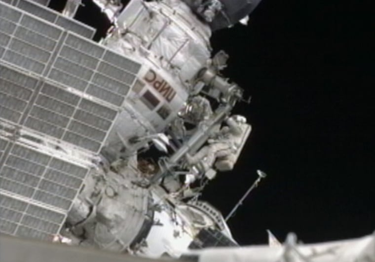 Russian cosmonauts Sergei Volkov and Alexander Samokutyaev work with a boom on the exterior of the International Space Station during Wednesday's spacewalk.
