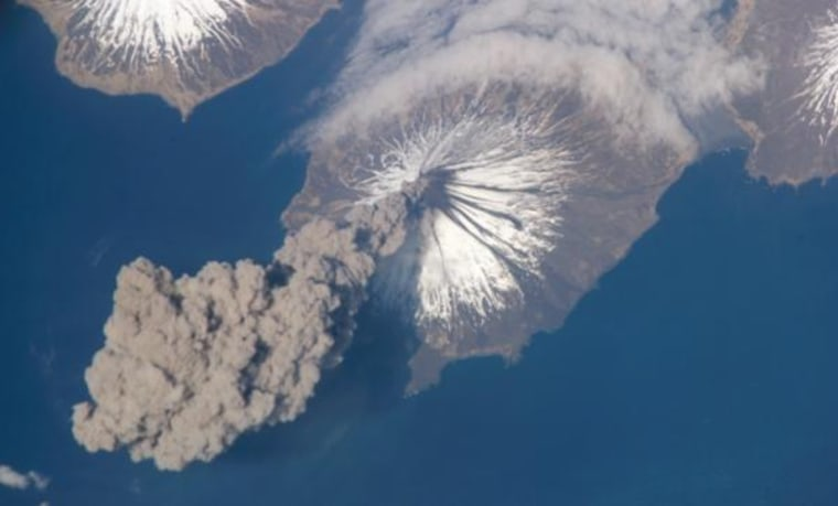 A plume of ash spews from the Cleveland Volcano in 2006.