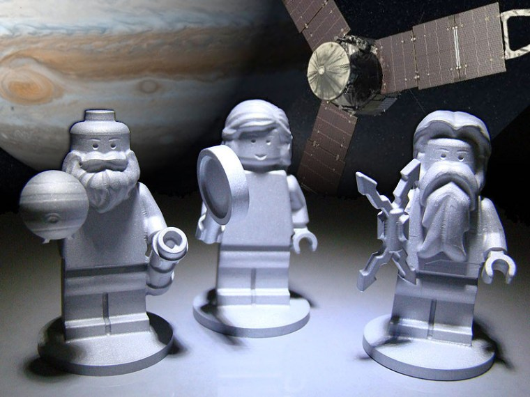 Three Lego figurines representing the Roman god Jupiter, right, his wife Juno, middle, and Galileo Galilei are flying to Jupiter on NASA's Juno spacecraft.