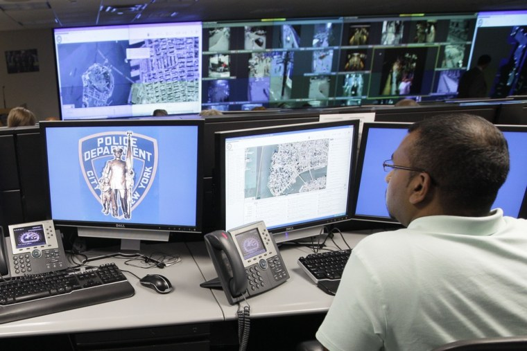 Image: Police officer monitoring live video