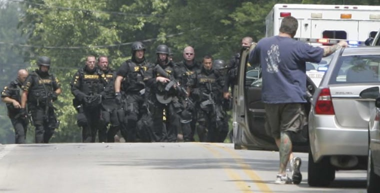 Image: Members of the Summit County Sheriff Department leave the scene of a multiple fatal shooting
