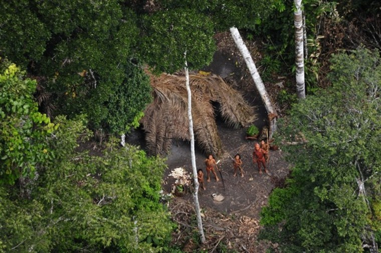 This 2010 image shows part of an uncontacted Indian tribe in western Brazil. The tribe has disappeared since a group of armed men (presumed to be Peruvian drug traffickers) overran a Brazilian guardpost near the tribe's lands. Brazilian officials are now looking for signs of the missing tribe.