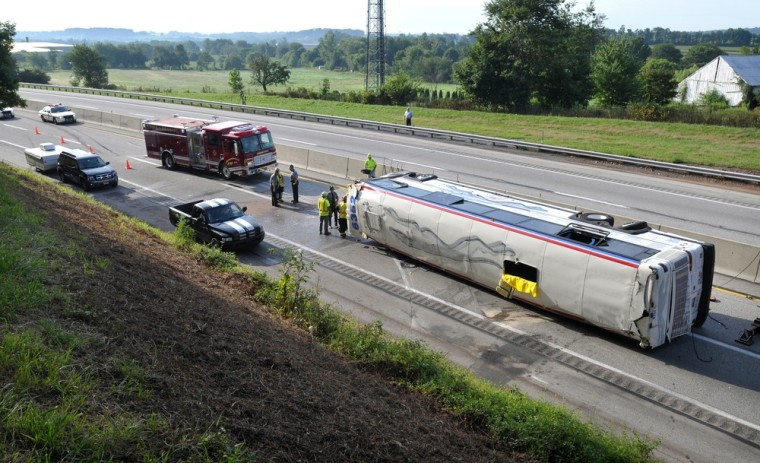 Image: Emergency personnel work scene of bus accident