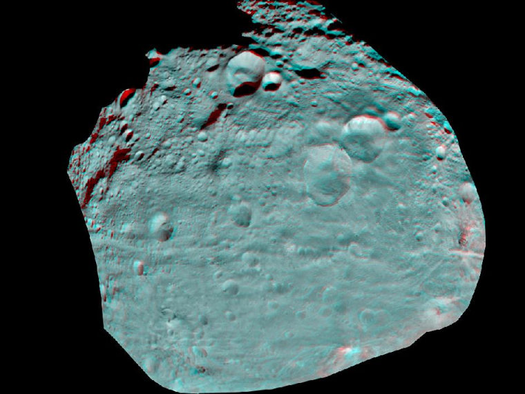 This anaglyph image of Vesta's equator was put together from two clear filter images, taken on July 24 by the framing camera instrument aboard NASA's Dawn spacecraft. The image shows hills, troughs, ridges and steep craters in 3-D.