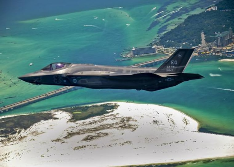 The first U.S. Air Force F-35 Lightning II joint strike fighter (JSF) soars over Destin, Fla., before landing at its new home at Eglin Air Force Base on July 14. Its pilot, Lt. Col. Eric Smith of the 58th Fighter Squadron, is the first Air Force qualified JSF pilot.