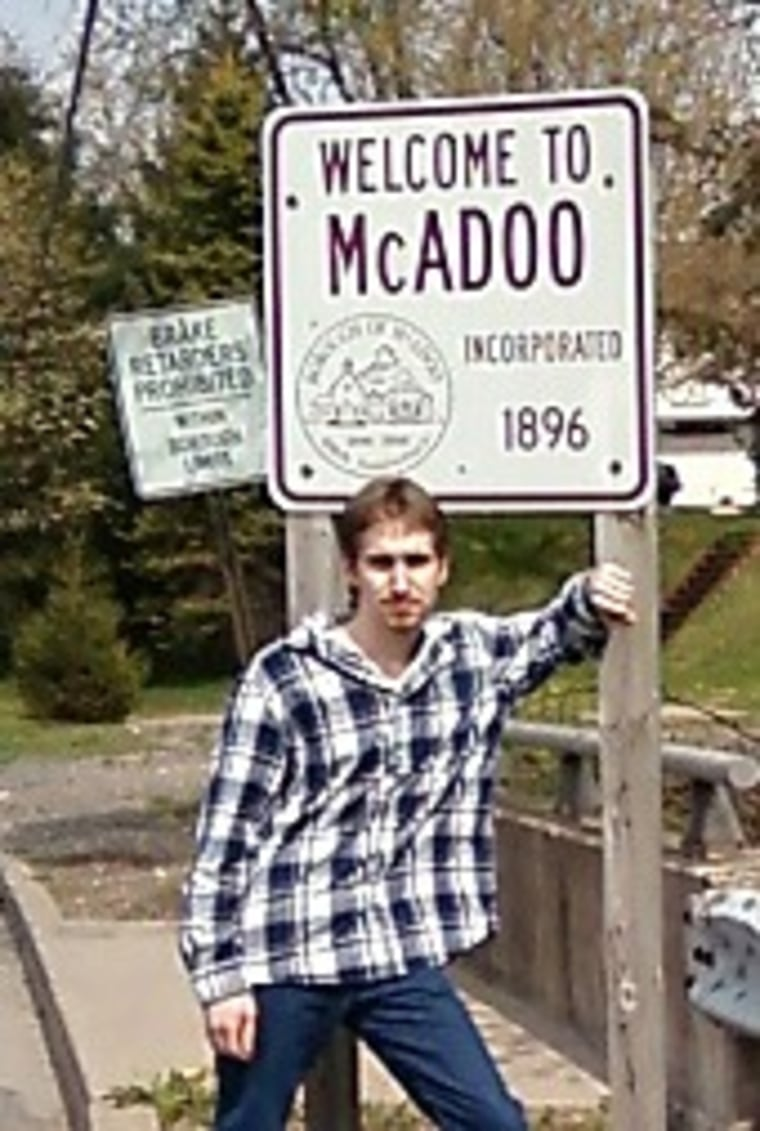 Image: Shawn Christy, a 19-year-old Pennsylvania man stands in front of a sign in his hometown of McAdoo, Pa.