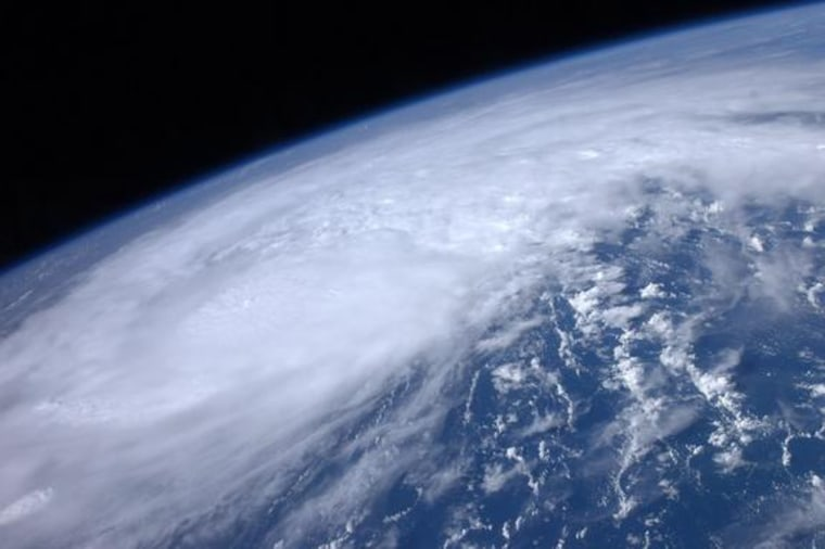 High above the Earth from aboard the International Space Station, astronaut Ron Garan snapped this image of Hurricane Irene as it passed over the Carribean on Monday.