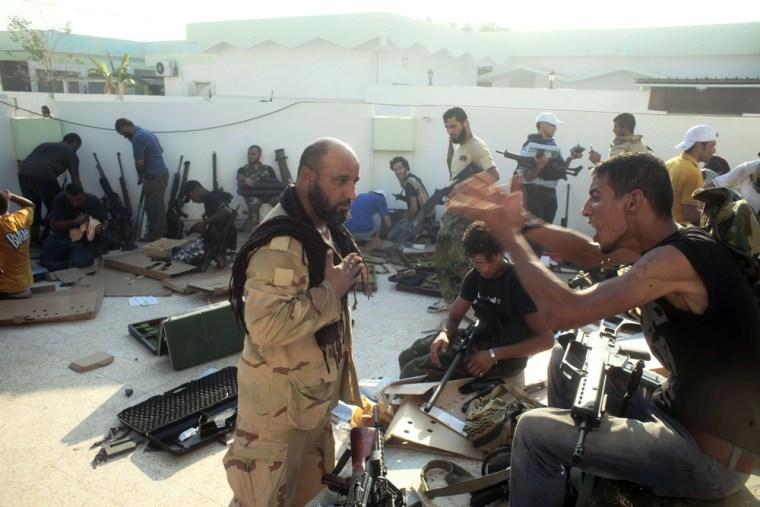 Image: Libyan Rebels Attack Gaddafi's Bab al-Aziziya Compound - Tripoli