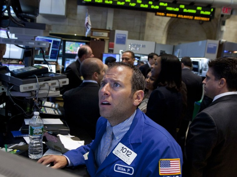 Image: A trader works on the floor of the New York Stock Exchange on Friday, Aug. 26, 2011
