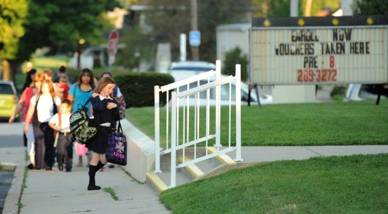 Image: Students enter Our Lady of Hungary Catholic School