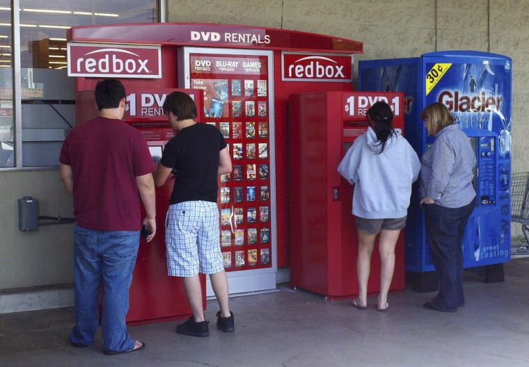 Image: Customers rent DVD movies from a redbox video kiosk