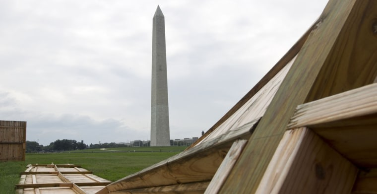 Image: A fallen wooden state park fences is seen on the ground near the Washington Monument
