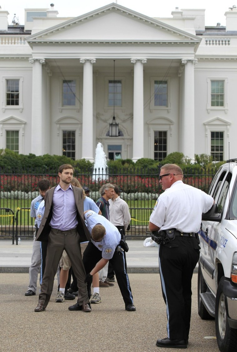 Image: A protestor is arresed in front of the White House