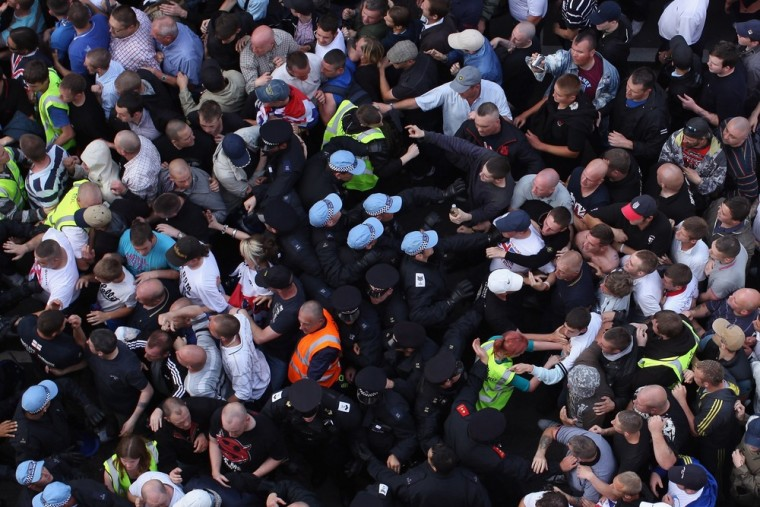 Image: Members of the English Defence League (EDL) clash with police