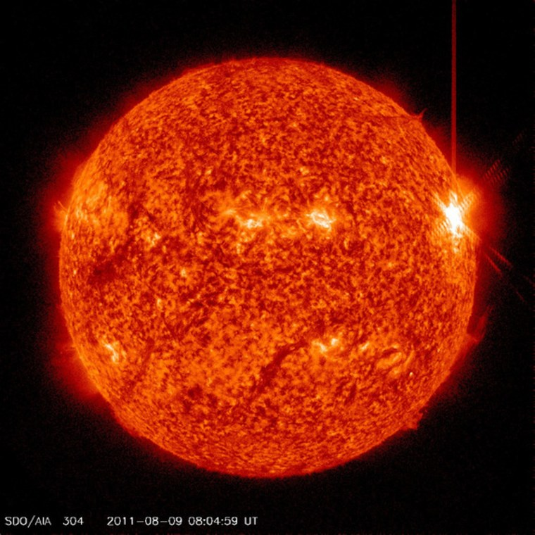 This image from the Solar Dynamics Observatory shows the X6.9 solar flare of Aug. 9 near the western limb (right edge) of the sun.