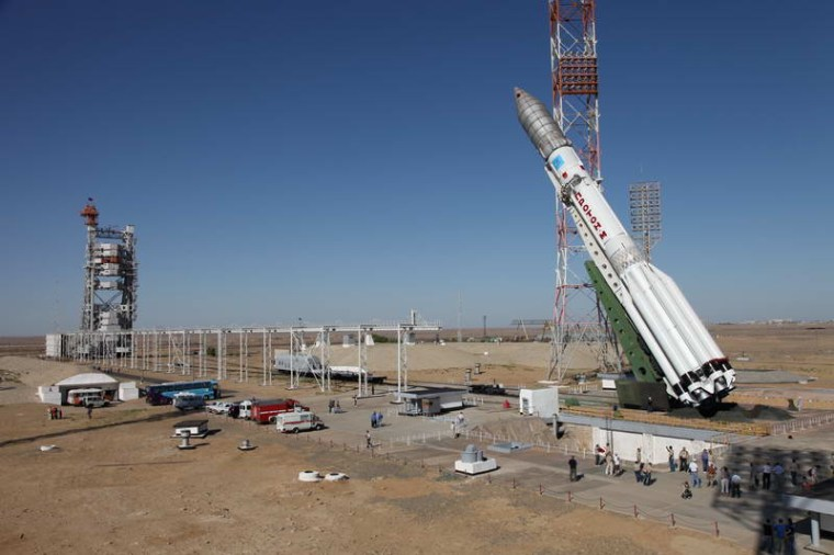 A Russian Proton rocket is hoisted into launch position for the Aug. 17 launch of the new Express AM4 communications satellite from Baikonur Cosmodrome in Kazakhstan. The mission failed.