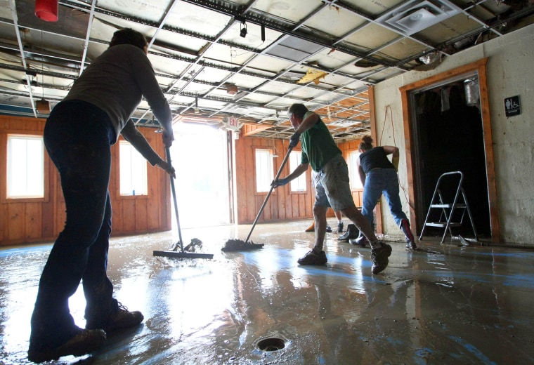 Image: Friends and family work to clean J.J. Banko's Seafood Restaurant