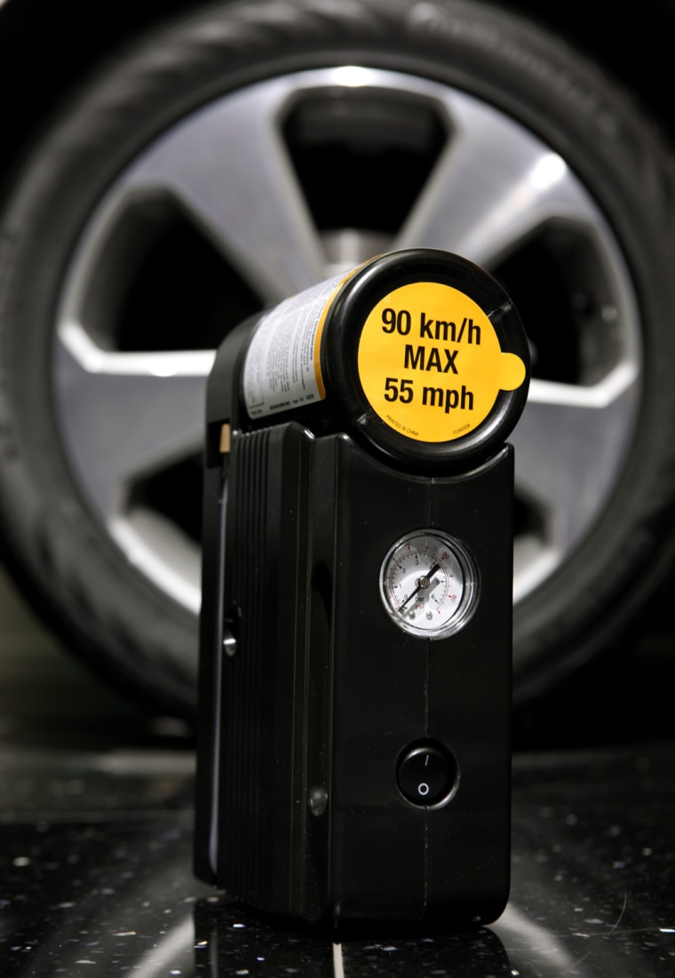 Image: tire inflator near the tire