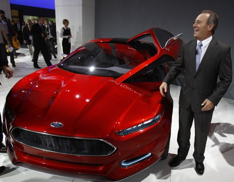 Image: Odell, CEO of Ford Europe poses next to the new Ford Evos Concept car at the International Motor Show (IAA) in Frankfurt