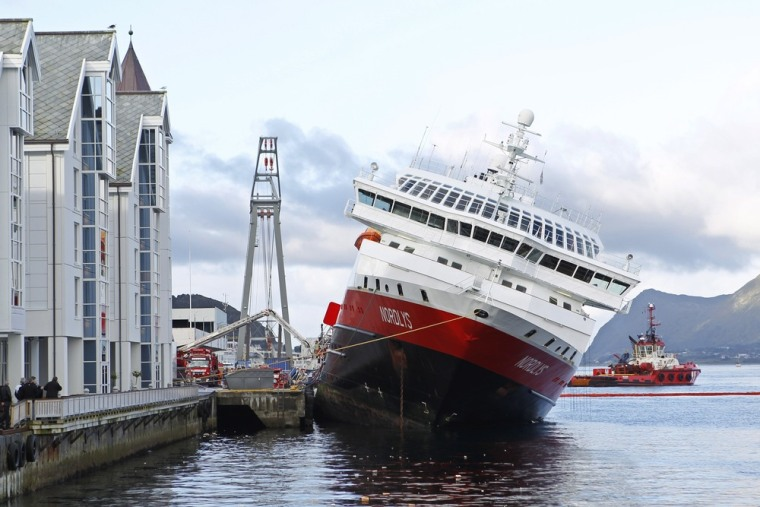 """Image: Norwegian fjord cruise ship  """"Nordlys"""" (Northern Light) sits stricken in the water at Aalesund"""