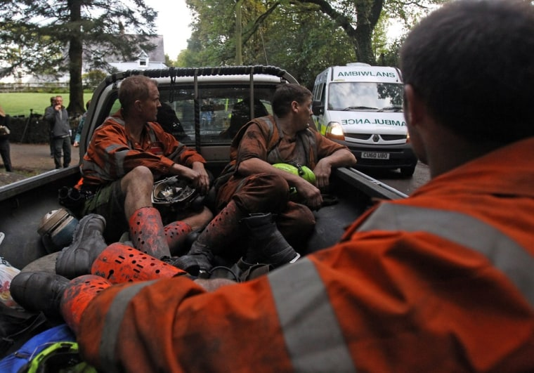 Image: Mine rescue workers prepare to join the continuing operation to rescue four Welsh miners