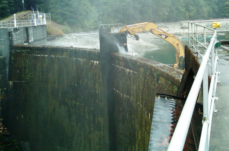 Image: Concrete chipped away on dam