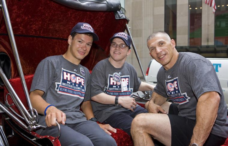 Image: Joe Girardi, right, with Andrei Sullivan, 19, left, and John Lahutsky