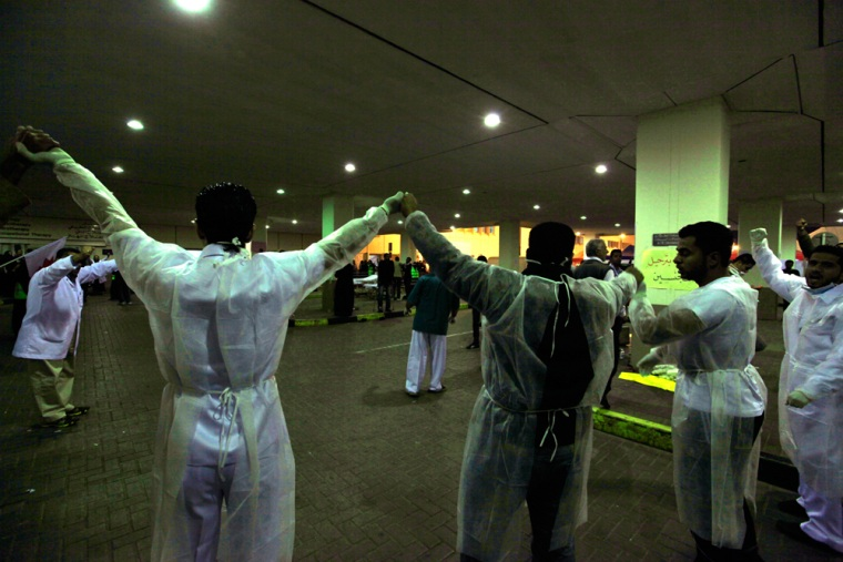 Doctors form a human chain at Salmaniya Hospital fearing an attack by riot police in Manama, Bahrain, on March 15.